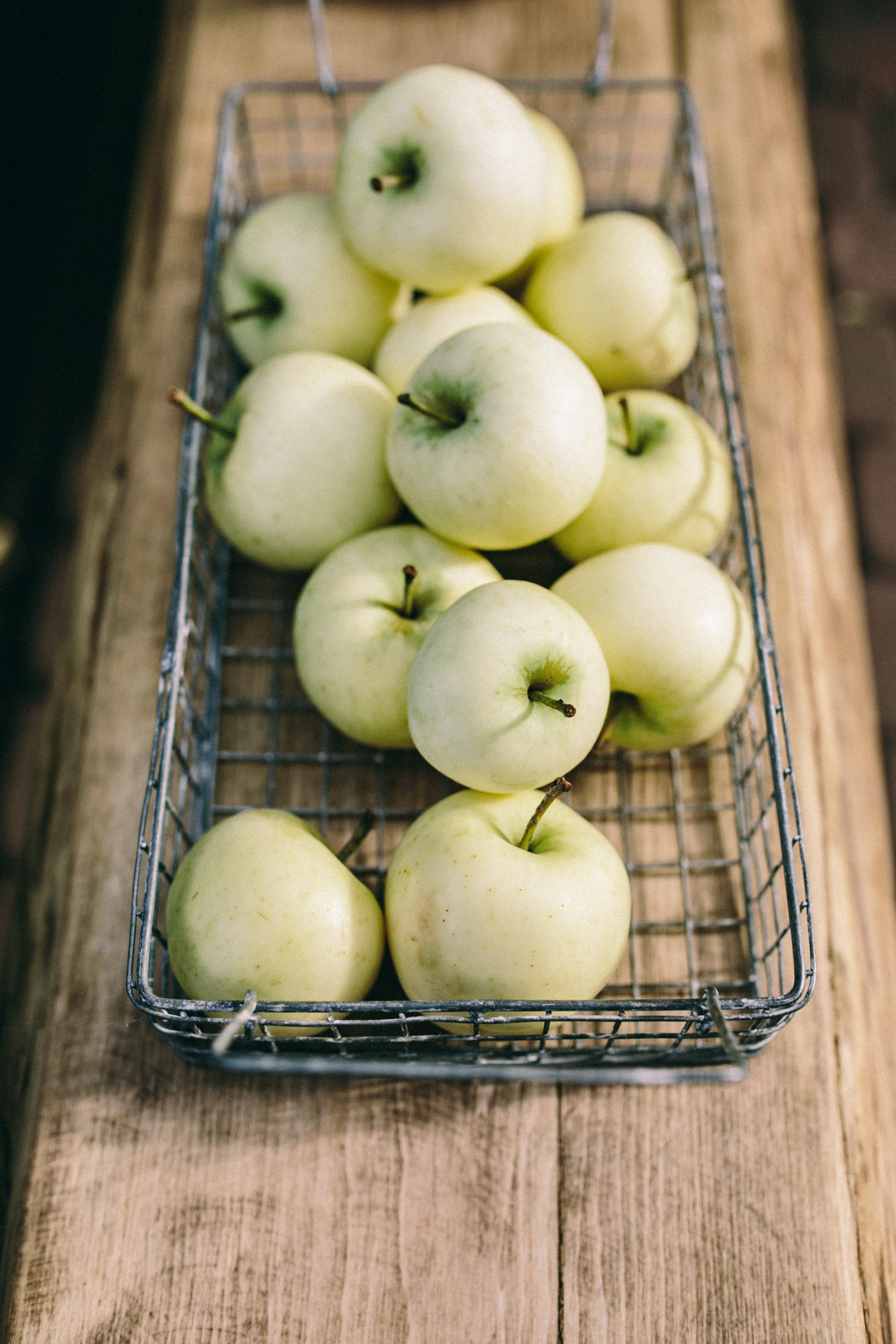 Photo of Green Apples in Wire Basket