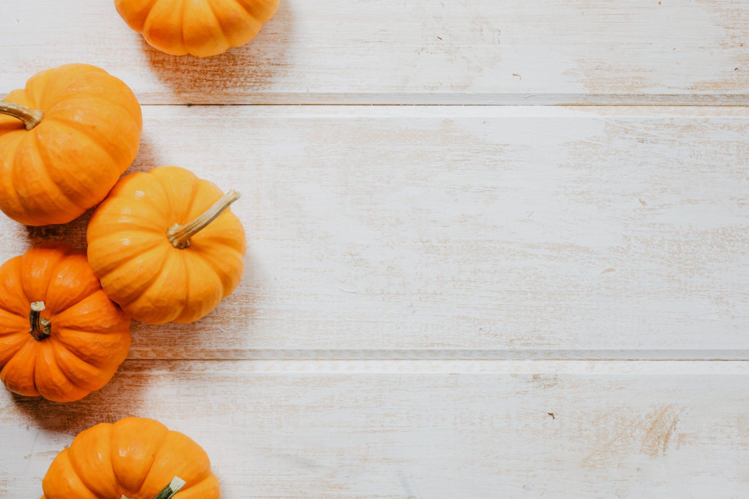 Photo of Mini Pumpkins on White Wood