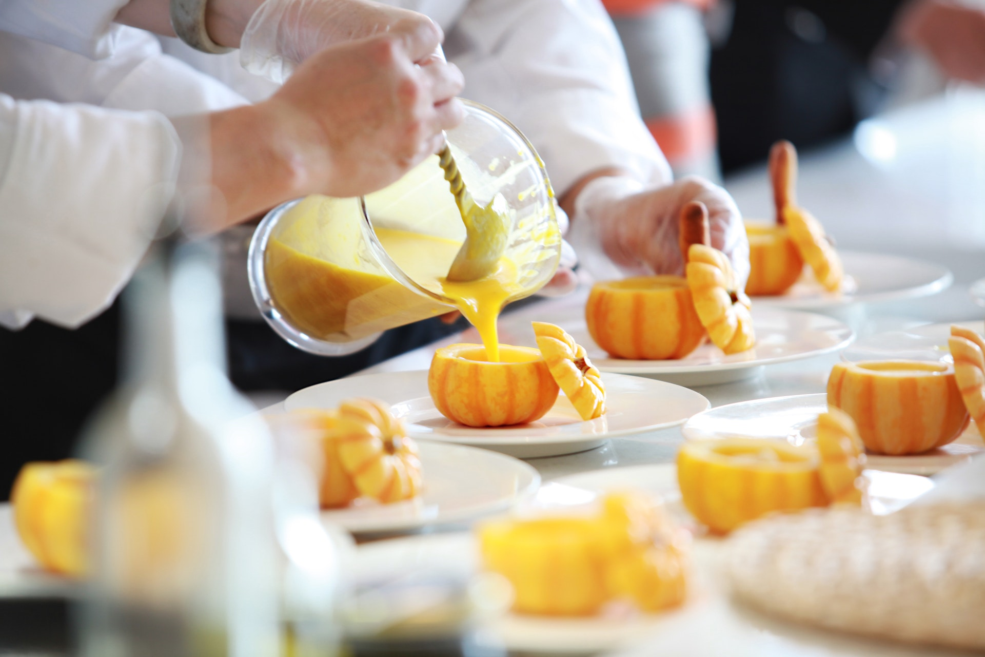 Photo of Pouring Soup into Pumpkin Bowls