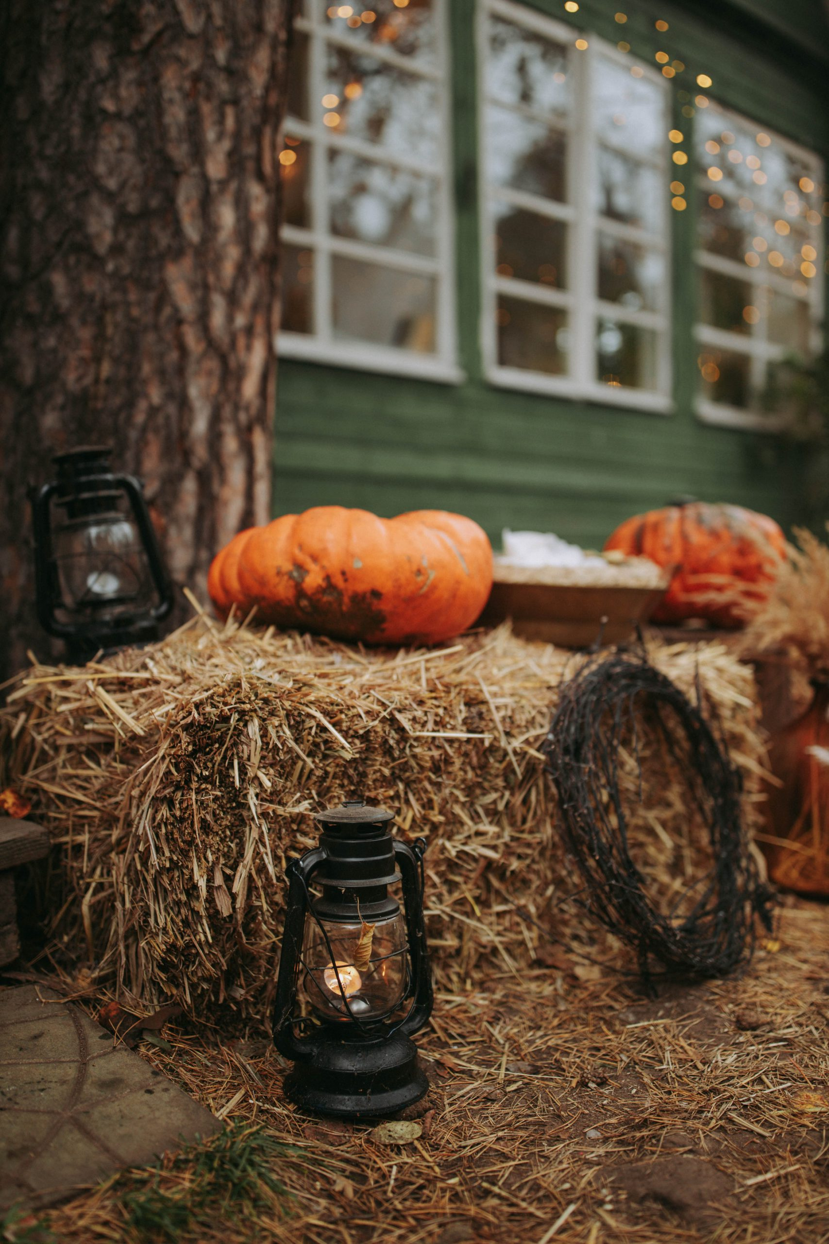 Photo of Pumpkins & Lanterns on Hay Bales
