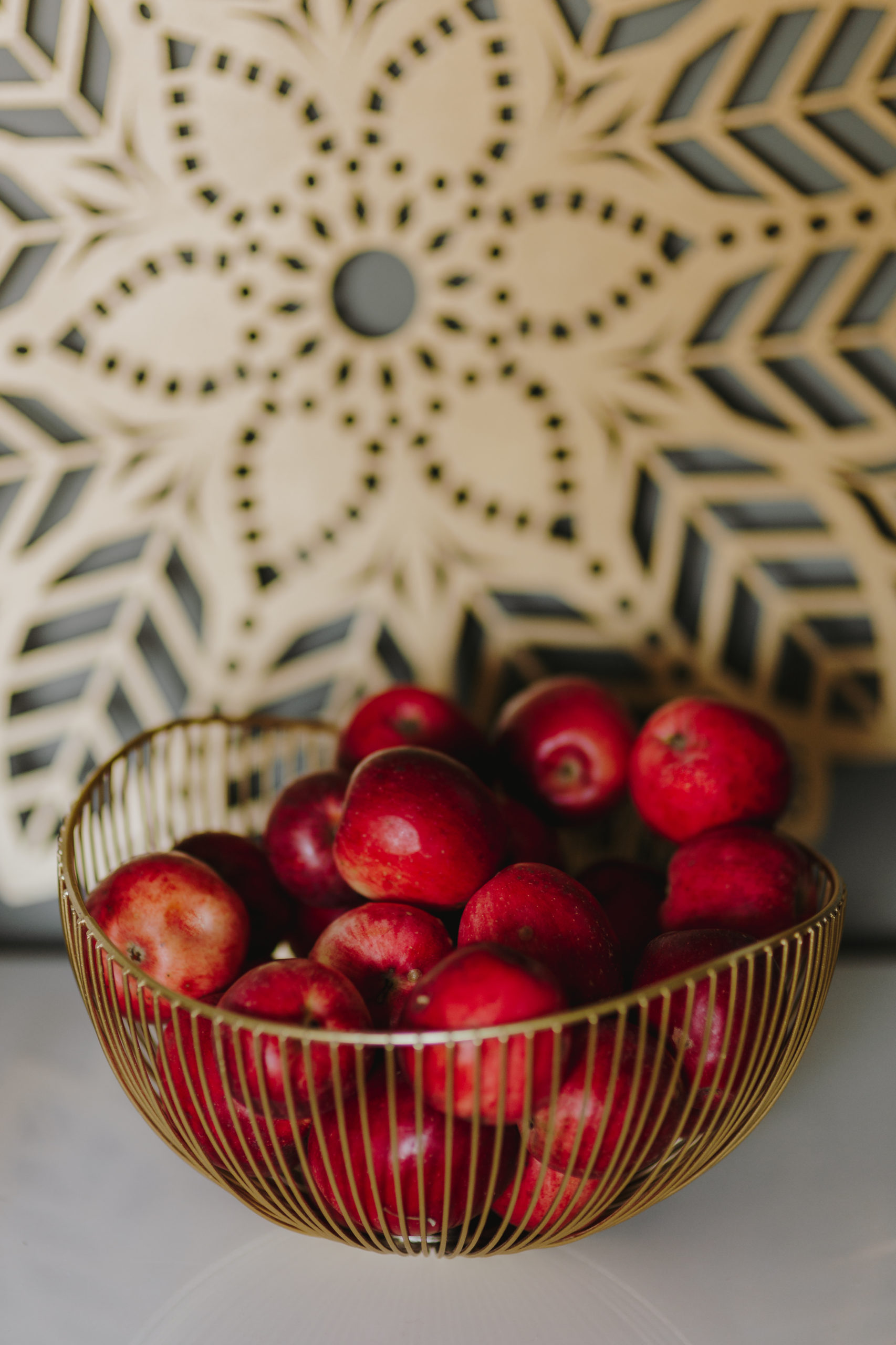 Photo of Red Apples in a Gold Basket