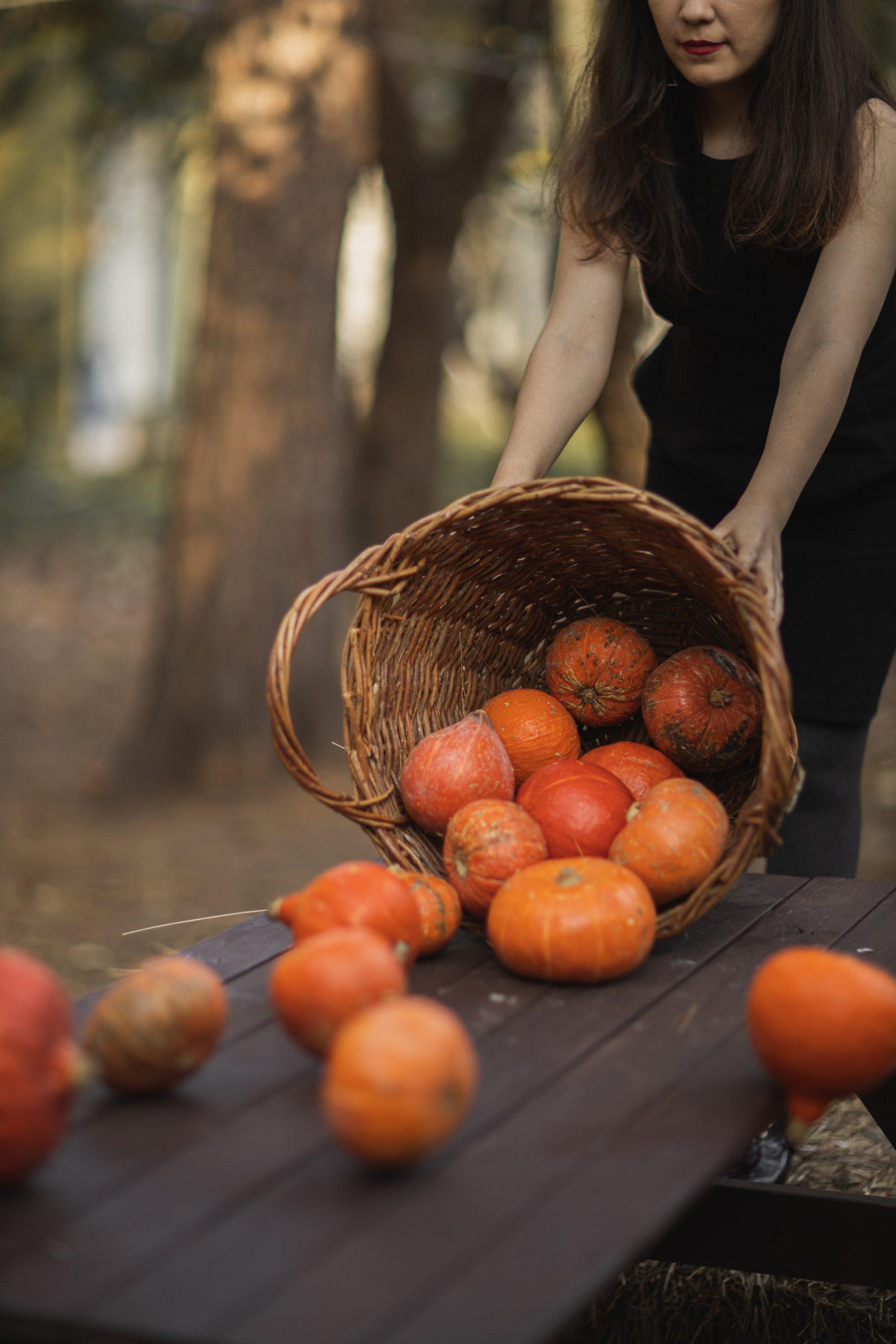 Photo of Woman Dumping Pumpkins